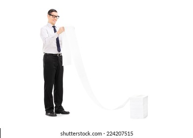 Joyful man looking at a very long list isolated on white background