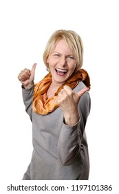 Joyful mature woman happy rejoices and gesturing thumbs up isolated on white background