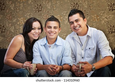 Joyful Native American family sitting together indoors