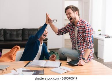 Joyful positive men being in a great mood