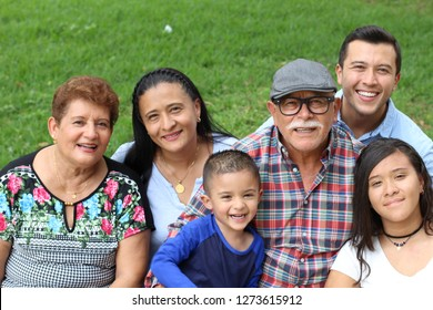 Joyful real ethnic family portrait