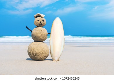 joyful Sandman of white sand on the clean beach of an exotic island on the background of blue sea and cloudy sky. Sand surfer. creative idea of surfing. the concept of marine sports