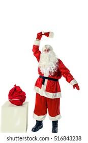 Joyful Santa Claus. Santa Claus with bag of gifts. Santa Claus isolated on white.
