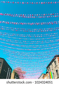 Joyful street in gay neighborhood decorated with pink balloons. Annual summer installation in gay village on Ste-Catherine street, Montreal (Quebec, Canada).