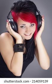 Joyful teenage girl with headphones