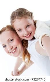 Joyful toddler on back of her mother