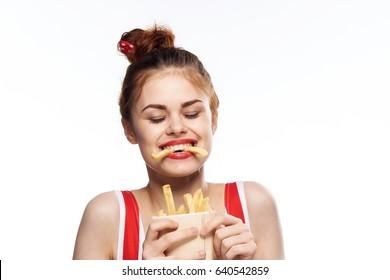 Joyful woman with fried fatty potatoes, fatty potato food, woman with french fries