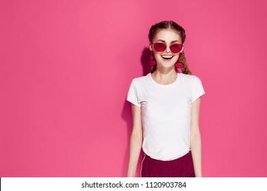 joyful woman in glasses in a white t-shirt glamor