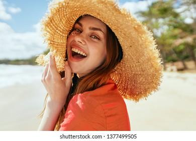 joyful woman in hat on the beach portrait