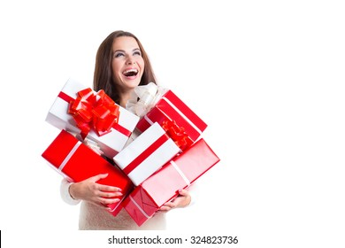 Joyful woman woman holding a lot of boxes with gifts on a white background.