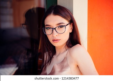 Joyful woman maintaining fashion blog. summer fashion and beauty look. sexy woman in glasses. stylish and trendy student girl. Tattoo. Fashion portrait of woman. Feeling flirty. Young expertise.