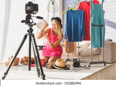 Joyful woman maintaining fashion blog