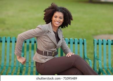 Joyful woman sitting in the park