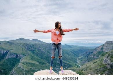 joyful woman travel mountains. Authentic brunette female relax in picturesque landscape. Montenegro, Prokletije