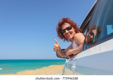 Joyful woman travelling on a white car . Copy space for your text.