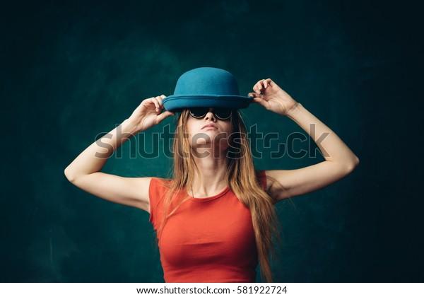Joyful woman wears a hat, a bright background