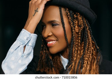 Joyful young African American woman smile. Happy model. Smiley female on black background, fashion style, happiness concept