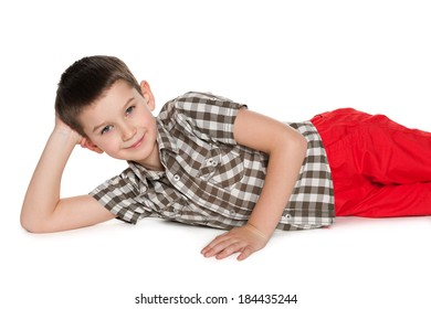 A joyful young boy with is lying on the white background