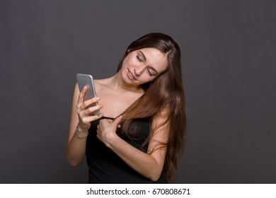Joyful young woman taking selfie by her smart phone. Attractive girl making picture of herself, instagram, modern lifestyle concept