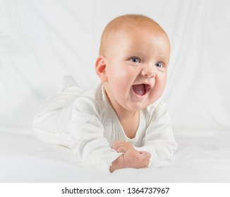 joyfull and happy baby shot over white