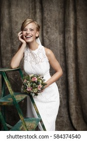 Joyous bride with flowers, smiling