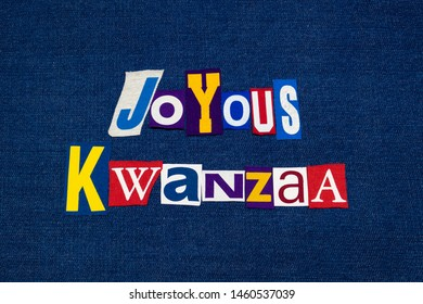 JOYOUS KWANZAA word text collage typography, multi colored fabric on blue denim, African American holiday, horizontal aspect