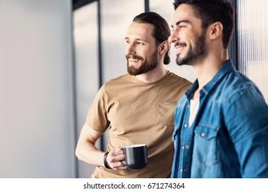 Joyous smiling men having rest