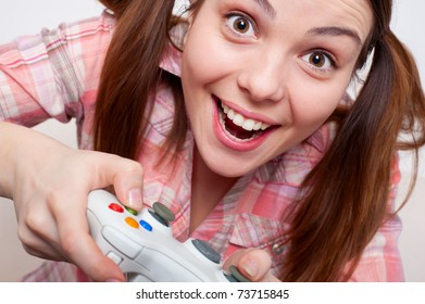 joyous young woman playing video game