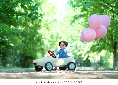 joyride - cute little girl enjoy a ride on her car