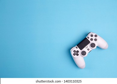Joystick gaming controller isolated on blue background , Video game console developed Interactive Entertainment