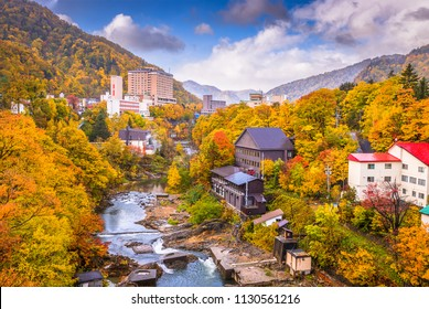 Jozankei, Japan inns and river skyline during the autumn season.