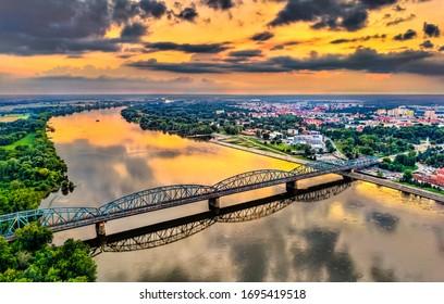 Jozef Pilsudski Bridge across the Vistula River at sunset in Torun, Poland