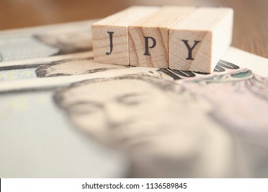 JPY (Japanese Yen) Text Block on Wooden Table