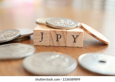 JPY (Japanese Yen) Text Block on Wooden Table