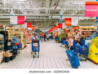 Juan les Pins, France - August 27, 2017: Shoppers in a Carrefour supermarket, one of the largest supermarket chains in France