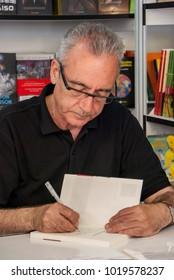 Juan José Millás signs his books at the Madrid Book Fair in June 2011