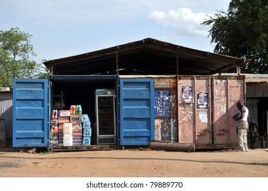 JUBA - JUNE 10: Unidentified men standing in front of containers turned into a shop in Juba, capital of South Sudan, on June 10, 2011. Containers are used in Juba for everything from shops to hotels.