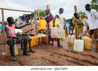 Juba, South Sudan - April 10, 2014: South Sudanese refugees get the daily ration of water