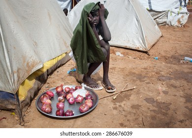 Juba, South Sudan - April 10, 2014: A South Sudanese child sells onions in a refugee camp