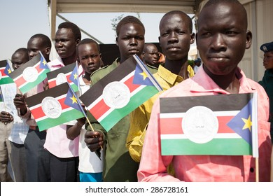 Juba, South Sudan - February 15, 2014: South Sudanese men wait in line to join a Sudan People Liberation Movement rally
