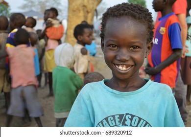 Juba, South Sudan, February 2017. Portrait of a little smiling girl at a camp for internally displaced persons (IDPs). Captured during civil war.