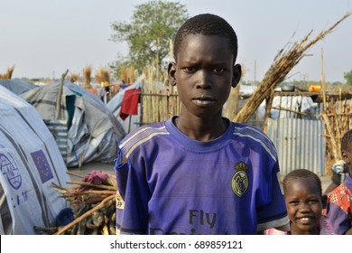 Juba, South Sudan, February 2017. Serious face of a teenage boy. Salesian camp for internally displaced persons (IDPs). Captured during civil war.