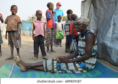 Juba, South Sudan, February 2017. Older woman sitting in front of her tent at a salesian camp for internally displaced persons (IDPs). Captured during civil war.