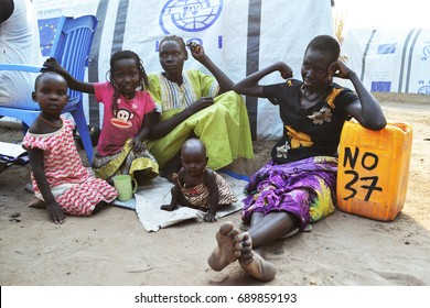 Juba, South Sudan, February 2017. Women and children sitting on the ground. Yellow jerrycan with number of a displaced family. Camp for internally displaced persons (IDPs). Captured during civil war.