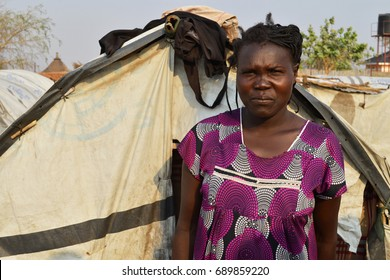Juba, South Sudan, February 2017. A woman standing in front of her tent at a salesian camp for internally displaced persons (IDPs). Captured during civil war.