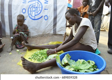 Juba, South Sudan, February 2017. A teenage girl is cutting cabbage at a salesian camp for internally displaced persons (IDPs). Captured during civil war.