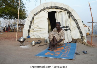 Juba, South Sudan, February 2017. An older woman sitting alone in front of her tent at a salesian camp for internally displaced persons (IDPs). Captured during civil war.