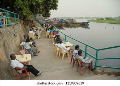 JUBA, SOUTH SUDAN - FEBRUARY 26 2012: Unidentified people take a rest in open air restaurant at Nile riverside of Juba, South Sudan. There are few pricey restaurants on Nile waterfront in Juba.