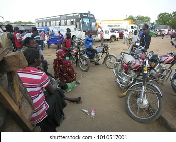 JUBA, SOUTH SUDAN - FEBRUARY 27 2012: Unidentified people wait for their buses at a bus station of Juba, South Sudan. There are international bus routs from Juba to Nairobi and Kampala .