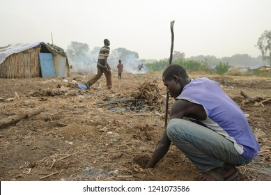 JUBA, SOUTH SUDAN - FEBRUARY 28 2012: Unidentified refugee digs a hole for a construction of new hovel in displaced persons camp, Juba, South Sudan. People stay here in harsh conditions for long time.